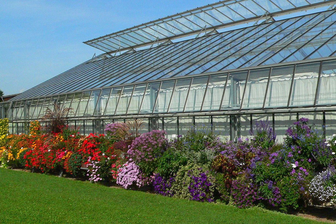 Balcony flower demonstration facility in front of the institute's greenhouses