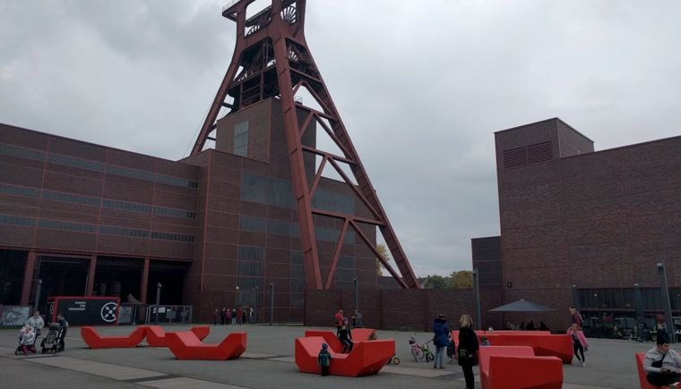 photo place with red furniture building and steel construction in the background